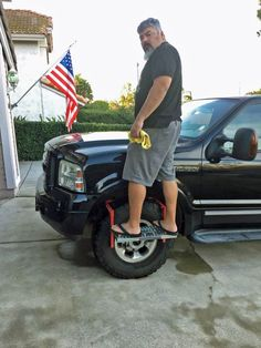 """Easily reach your vehicle's roof or do repair work under the hood with this tire step. Simply place the arms over your tire and adjust to fit, and you'll have a stable platform that supports up to 300 lbs. Fits tires up to 13"""" wide. Lowest Prices for the best truck bed accessories from Powerbuilt. Powerbuilt Adjustable Tire Step for SUVs, RVs, and Trucks - 300 lbs part number ALL647596 can be ordered online at etrailer.com or call 800-298-8924 for expert service."""