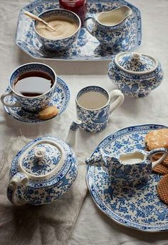 Pretty blue-and-white tea service. Consider using a brown or yellow tablecloth. The white cloth diminishes the delicacy of the blue.
