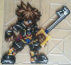 Perler of Sora from Kingdom Hearts in his outfit from KH2 wielding the Kingdom Key Used a sprite from CSW as a template SquareEnix owns the rights to Sora and Kingdom Hearts