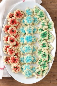 When I think of a cookie that can be found at just about every holiday party and gathering in Minnesota, I immediately think of classic spritz cookies. These Spritz Cookies are a classic holiday cookie that round out any cookie platter! Not too sweet and perfectly buttery, you'll want to make a batch of these...
