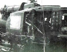 """""""Door gunner in a UH-1B Gunship of the 129th doing his job, 1967"""" - with kill markings on the side ~ Vietnam War"""