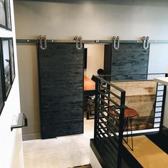 The office space of @jordaniversonsignaturehomes. Their custom bi parting doors are hung with Industrial Horseshoe Hanger by Rustica Hardware.