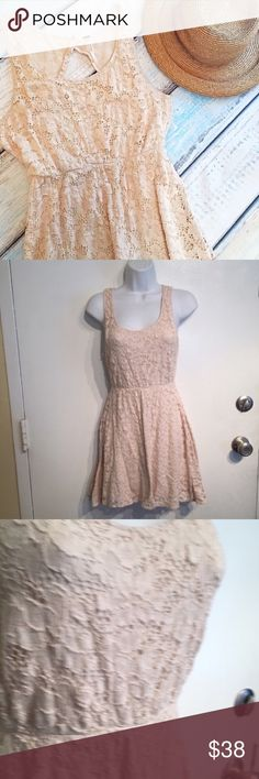 """FREE PEOPLE Cream Lace Open Back Dress Free People Lined cream Lace dress with open back. Size small. Can be dressed up or down. Minor piling on lining but can't be seen while wearing. Could be worn in a cute Gypsy Boho fashion or styled for a sexy and flirty look. Measures 16.5"""" flat from armpit to armpit and 32"""" long. Does stretch. No modeling. Smoke free home. I do discount bundles. Free People Dresses"""