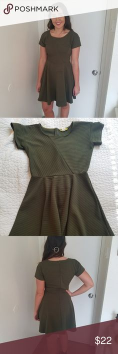 Army Green Skater Dress Minimal wear, great condition. Feel free to ask any questions!  My measurements: 5'7 Size 6 or 8 bottoms Small or medium tops Hips - 40 inches Waist - 27 inches Yellow Star Dresses Mini