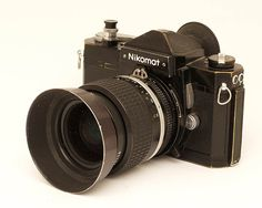 Nikomat was the Japanese name for the camera that was named Nikkormat in the west. I had one for several years, with a 35mm lens and the well-known 105mm. This is one of my favorite set-ups of all times. Note the nice soft release button.