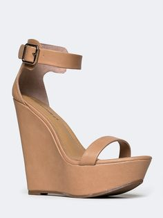 - These ankle strap sandals are gorgeous and simple wrapped into one! - Vegan leather wedge heels have a buckle closure at the ankle for a classic and versatile look. - Non-skid sole and cushioned foo