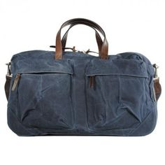 """tommy trip (indigo) is a stylish weekender from """"property of"""" out of waxed cotton canvas and leather"""
