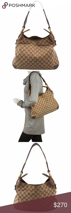 Gucci GG Canvas & Leather Hobo (137404) This Gucci shoulder bag features:  •Exterior corners show scuffing •Exterior piping shows scuffing throughout •Exterior GG canvas shows scuffing and discolorations throughout •Interior shows staining and wear throughout •Handle shows scuffing and wear •Hardware shows scratches and wear -Interior has a musty odor •Overall Condition: Pre-owned •Material: Canvas •Origin: Italy •Meas (L x W x H): 14x2x11 •Strap Drop: 7 •Odor: Musty/Chemical •Weight: 2 lbs…
