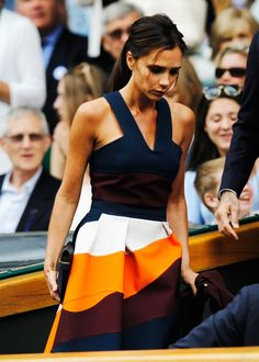 Victoria Beckham was not afraid to pair bold colors while watching a match at Wimbledon.