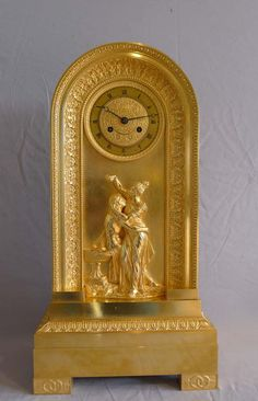 Antique French Empire ormolu clock of borne shape and of Hero and Leander. - Gavin Douglas Antiques