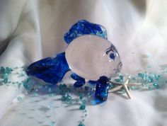 A personal favorite from my Etsy shop https://www.etsy.com/listing/181676560/whimsical-hand-blown-art-glass-fish