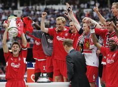 Lifting the FA Cup as Liverpool captain