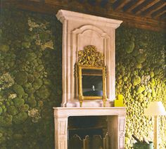 Amazing moss wall to cover cinderblock.  Love the idea of doing a mantle over top of the moss.  Hmmm.