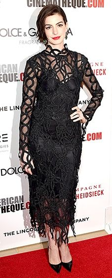 Anne Hathaway worked a rope-laced Christopher Kane LBD, a piece she paired with black heels and green earrings.