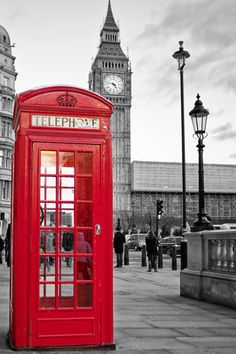 A Traditional Red Phone Booth In London With The Big Ben In A Black And White Background Premium Poster at AllPosters.com