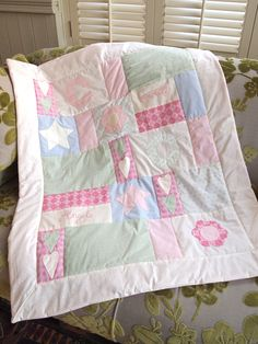 A quilt for my nieces new baby - a mixture of patchwork, applique and embroidery!