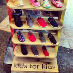 Picking out #TOMS for my son. Too many to pick from! This is the display at our local Journeys for Kids #WearTOMS