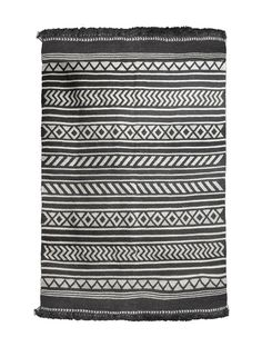 Black-White Geometric Woollen Durrie   This Kharad rug from Kutch is part of Jaypores commitment to support and celebrate lost textile crafts and narrate their stories.  - The Kharad adorned many palaces in Sindh and Gujarat, where the Kings and ministers were regular patrons of this craft, given its distinctive look, strength and longevity.