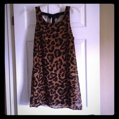 Leopard/cheetah dress with bow back Super cute cheetah / leopard print dress! Black bows down the back. Sheer material over black slip underneath. Dresses