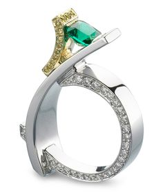 Platinum and 18k yellow gold ring featuring a 0.90ct cushion cut emerald, accented with 0.18ctw of yellow diamonds, and 0.56ctw of white diamonds.