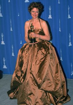 """1996 SUSAN SARANDON.  I remember watching this and thinking her dress was beautiful.  Ms Sarandon here with her Oscar for her performance in """"Dead Man Walking"""""""