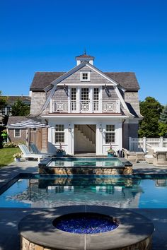 The owners of this shingle-style hilltop house wanted to turn it into an expansive, contemporary-feeling summer home for indoor-outdoor living, complete with a pool cabana and carriage house. Shingle Style Architecture, Greek Revival Architecture, Architecture Details, Pool Cabana, Modern Pools, Dutch Colonial, New England Homes, Maine House, House Tours
