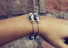 This wrap bracelet is made out of hand painted ceramic beads and silver colored spacers and beads. Thanks for checking out my shop! Beaded Wrap Bracelets, Hand Painted Ceramics, Ceramic Beads, I Shop, Sapphire, Buy And Sell, Rings, Silver, Handmade