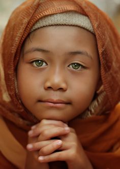 Pipie by Gansforever Osman, - A feature that stands out or grabs your attention, could be attractive, funny, or bring sorrow. Here is a child with beautiful eyes