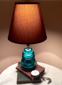 GLASS INSULATOR LAMP Handcrafted from Repurposed Vintage Hemingray 42 Telegraph Insulators and New UL Listed lamp parts. The antique glass insulators have a deep rich aqua blue color. Insulator Lights, Glass Insulators, Electric Insulators, Glass Bottles, Vintage Lighting, Cool Lighting, Lighting Ideas, Lampe Metal, Luminaire Original