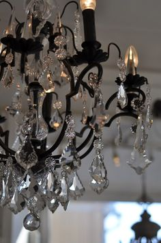 Black wrought iron crystal chandelier...can't find the candlestick covers I like so thinking this look is bold..maybe spray stick covers in rustoleum textured black..my favorite wrought iron spray paint!