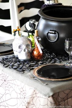 Snake Table Runner With rubber snakes and bugs, you can make a spooky table runner or placemat for Halloween dinner!