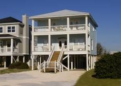 This beautiful two-story four bedroom and four and a half bath home is located in the Beachside Romar Subdivision, which is approximately four miles East of Highway 59. Tide Pride has multi-level deck...