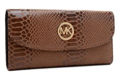 """Michael Kors Coffee Patent Python-Embossed Leather Wallet  Products Description * Michael Kors Coffee Patent Python-Embossed Leather Wallet. * Golden hardware. * Flap front with MK logo circle plate. * Logo plate at top center. * Inside, center zip compartment. * 4""""H x 8 1/4"""" x 1/2""""D."""