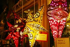 Colorful star lanterns from India in more than 20 designs. They fold flat for easy packing. $16.95 plus light cord.