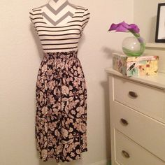 Pattern skirt This skirt has an elastic top (will stretch)! It also has a tie (for show). Can be worn with a crop top as shown in the pictures or it can be worn around the waist! Very thin! NEVER WORN! Charlotte Russe Skirts