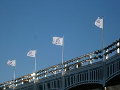 Championship flags on the frieze at Yankee Stadium.