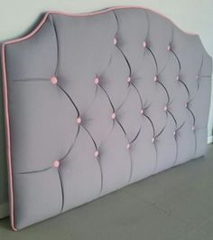 Grey and pink tufted upholstered headboard custom wall mounted