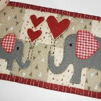 Red Elephants Mug Rug