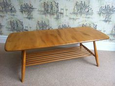 retro ercol blonde elm wood coffee table with magazine rack under