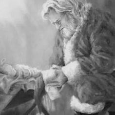 Santa kneels at the manger picture