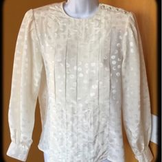 VINTAGE CREAM BLOUSE VINTAGE!! Cream blouse with circle detail. Buttons on left shoulder. Shoulder pads inside. Seam pleats in the front for a classy detail. Beautiful! -No trades. Vintage Tops Blouses