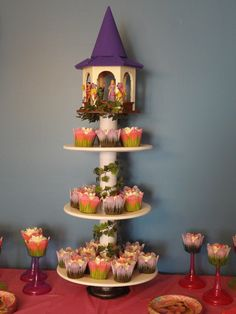 **Rapunzel's Cupcake Tower**   Took a little while but so worth it!!!