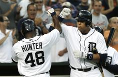 Detroit Tigers' Torii Hunter (48) celebrates his solo home run with teammate Miguel Cabrera in the third inning of a baseball game against the Oakland...