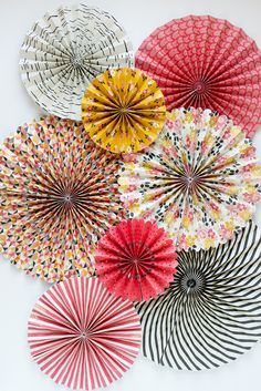 My Story Party Fans Rosette Pinwheels MME, 8 Fans. These lively colors and darling patterned fans are a perfect addition to a wedding, birthday party or shower! Perfect for as a photo background too!