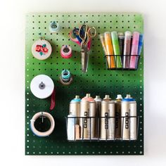 Organize your craft supplies better with this diy ombre pegboard. Only takes ten minutes and two cans of spray paint to make!