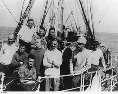 """GENERAL: Leader of the B.A.N.Z. Antarctic Research Expedition, Sir Douglas Mawson, with other members on board the """"Discovery"""""""