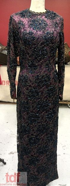 This special lady lives in the beaded gowns section of the warehouse. She is dark and mysterious! I love the idea of an older woman wearing it while admitting her evil plans to her latest victim. However, whoever wears this dress better be determined as the beading on this gown weighs a ton!