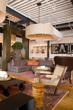 Rich colors, natural woods, industrial style lighting | Searsucker Restaurant in San Diego