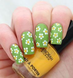 Nail Art Ideas- Spring Daisies Looking for a super cute nail tutorial which will get you noticed this summer? Then look no further than our summer must have spring daisy nail tutorial, you won't believe how easy it is to do!