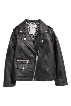 Black. Biker jacket in imitation leather with notch lapels with decorative press-studs. Shoulder tabs and a diagonal zip at the front, one fake zipped pocke
